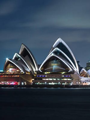 Sydney, Australia - February 21, 2013: Sydney Opera House at night from Harbour bridge. It is one of the 20th century's most distinctive buildings and one of the most famous performing arts centres in the world.