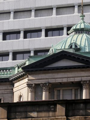 A Japanese flag flies atop the Bank of Japan (BOJ) headquarters in Tokyo, Japan, on Tuesday, March 17, 2015. Haruhiko Kuroda, governor of the Bank of Japan (BOJ), said he couldn't rule out the risk of consumer prices falling in Japan after the central bank on Tuesday maintained record monetary stimulus. Photographer: Yuriko Nakao/Bloomberg via Getty Images